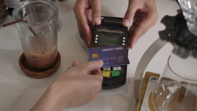 coffee shop is a small business shop. credit card accepting service with an electronic card swipe - computer chip stock videos & royalty-free footage