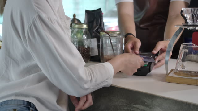 coffee shop is a small business shop. credit card accepting service with an electronic card swipe - manager stock videos & royalty-free footage