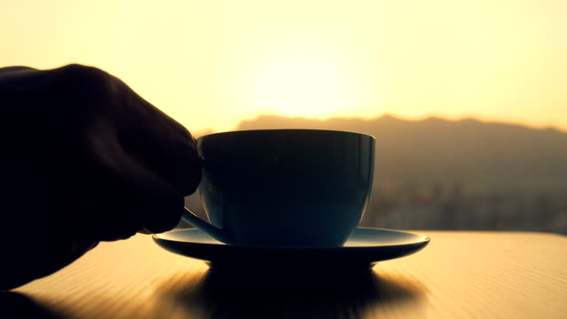 coffee time in the morning - holding stock videos & royalty-free footage