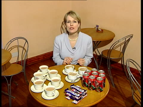 coffee warning for pregnant women; england: london: int cup of coffee as stirred with spoon cmss woman drinking coffee i/c cms coffee poured from... - itvイブニングニュース点の映像素材/bロール