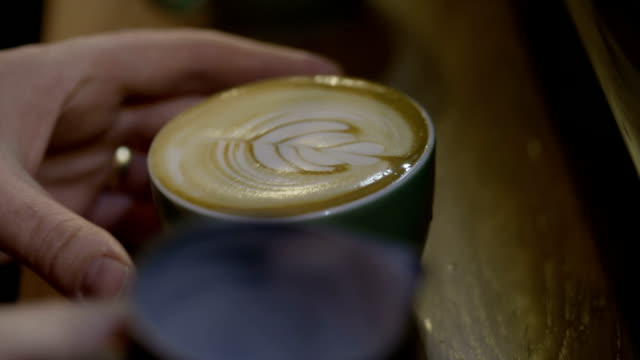 coffee with froth art - froth art stock videos and b-roll footage