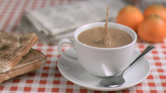 coffee with milk in super slow motion receiving sugar - sugar cube stock videos & royalty-free footage