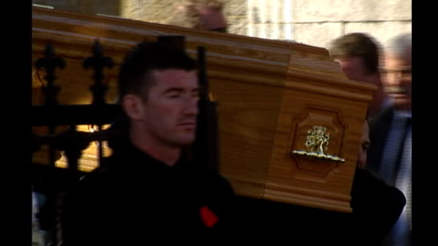 stockvideo's en b-roll-footage met coffin carried from church by gately's borther and boyzone members - boyzone