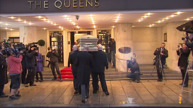 the coffin of broadcasting legend sir jimmy savile arrived at a hotel in his home city today where he will lie in state before his funeral the... - ジミー サヴィル点の映像素材/bロール