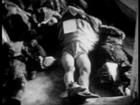 coffins for children killed by the fascist bombs / dead children in coffins / woman wounded and in hospital because of bomb that also killed her child - civil war stock videos & royalty-free footage