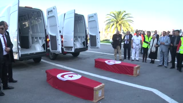 coffins of tunisian couple mohamed ali azzabi and senda nakaa who were killed in istanbul nightclub terror attack are received by their relatives at... - carthage tunisia stock videos & royalty-free footage