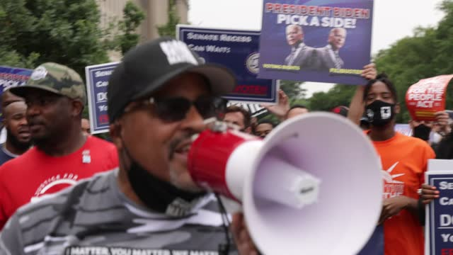 co-founder and executive director of black voters matter, cliff albright, shouts slogans during a march on voting rights from national museum of... - african american culture stock videos & royalty-free footage