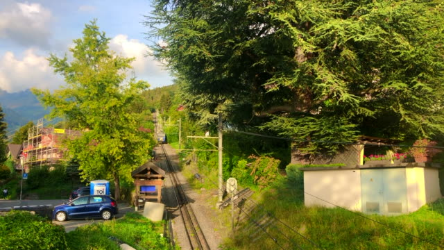 cog railway line and train groing from montreux to rochers-de-naye (2042 m), making stop at the village of glion - montreux stock videos & royalty-free footage
