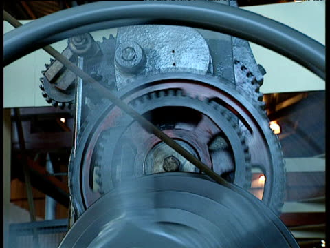 cogs wheels and belt drive on industrial machine - lokomotive stock-videos und b-roll-filmmaterial