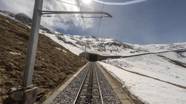POV Cogwheel train traveling to the top of mountain / Zermatt Switzerland