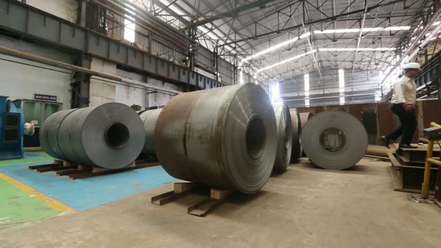 a coil of steel is unrolled in the tube mill at the manufacturing facility of uttam galva steels ltd the indian unit of arcelormittal in khopoli... - steel stock videos & royalty-free footage