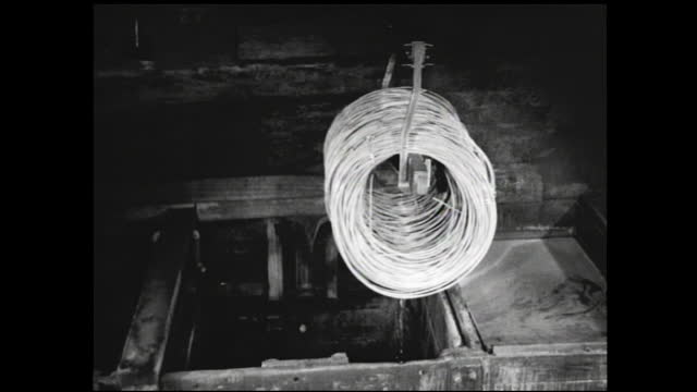 vídeos y material grabado en eventos de stock de coils being dipped in acid bath and lifted by overhead cranes; coil rinsed then dipped in steaming water - 1940 1949
