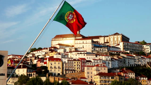 coimbra old town and portugal flag seen from the river - portugal stock videos & royalty-free footage