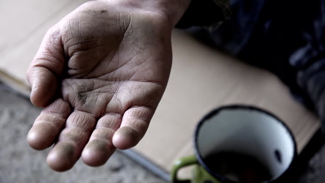 hd slow-motion: coin on a homeless person's palm - hemlöshet bildbanksvideor och videomaterial från bakom kulisserna