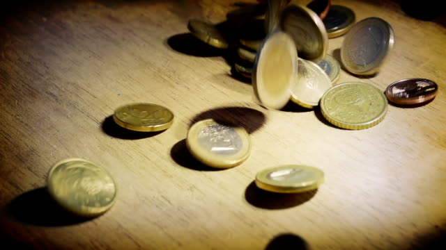 coins falling down. slow motion - european union coin stock videos & royalty-free footage