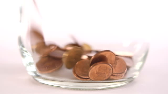 Coins falling into jar - slow motion