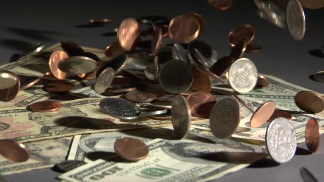 CU, Coins falling on American dollar bills