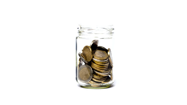 coins in a jar. - euro symbol stock videos & royalty-free footage