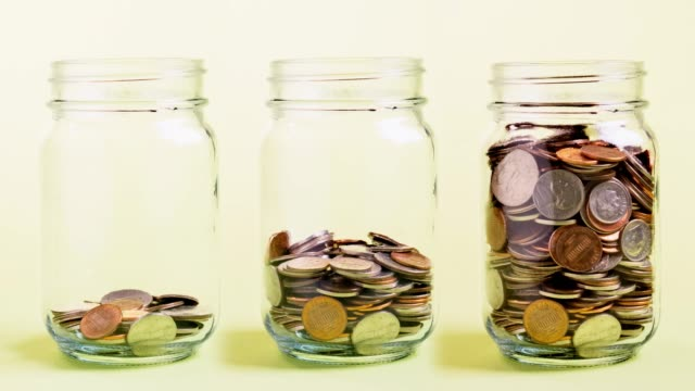 coins in a jar - filling stock videos & royalty-free footage