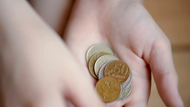 coins in children's hands, close up - coin stock videos & royalty-free footage