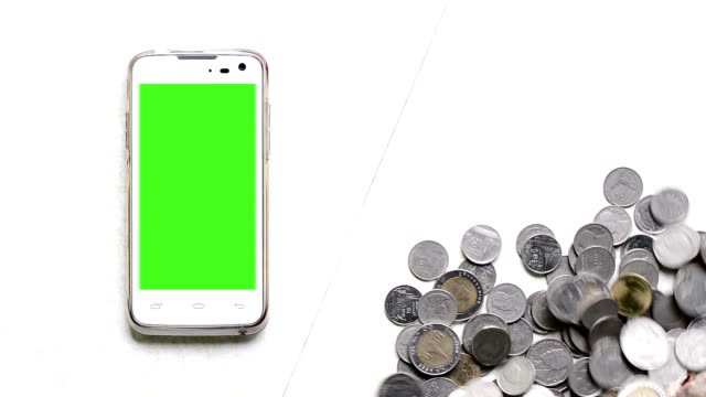 coins increase and green screen of smart phone. - digital enhancement stock videos & royalty-free footage