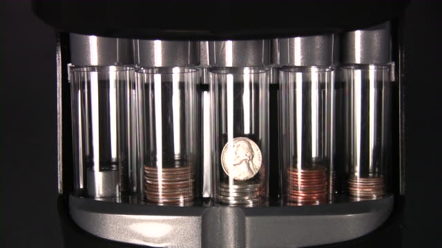 coins: quarter, nickel, dime, penny (time lapse) - dime stock videos and b-roll footage