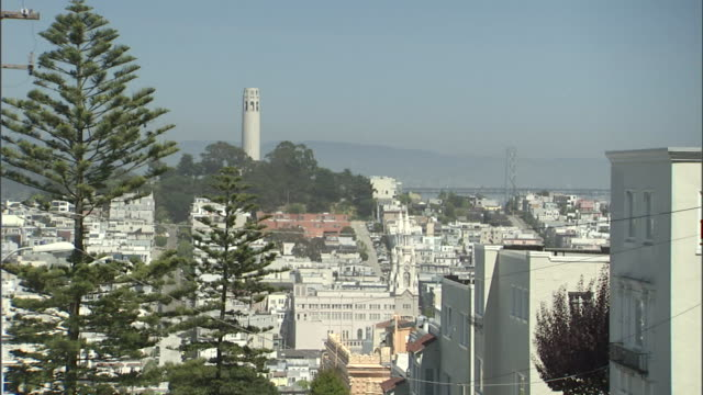 coit tower dominates the coastal skyline of san francisco. - coit tower stock videos & royalty-free footage