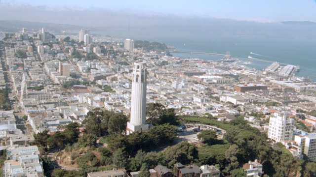 coit tower overlooks san francisco from telegraph hill - coit tower stock videos & royalty-free footage