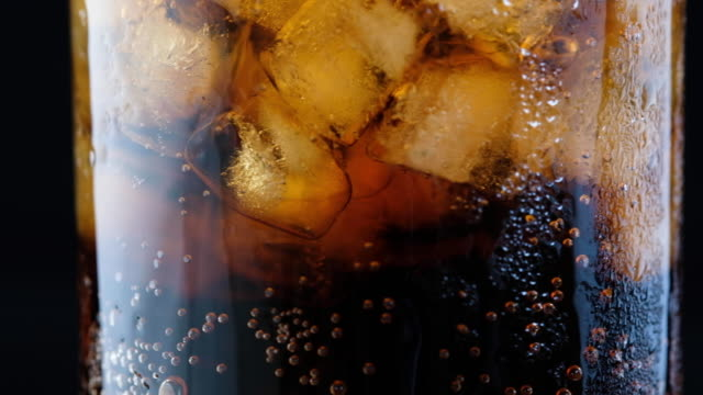 coke coca cola bubbles in glass with ice - carbonated stock videos & royalty-free footage
