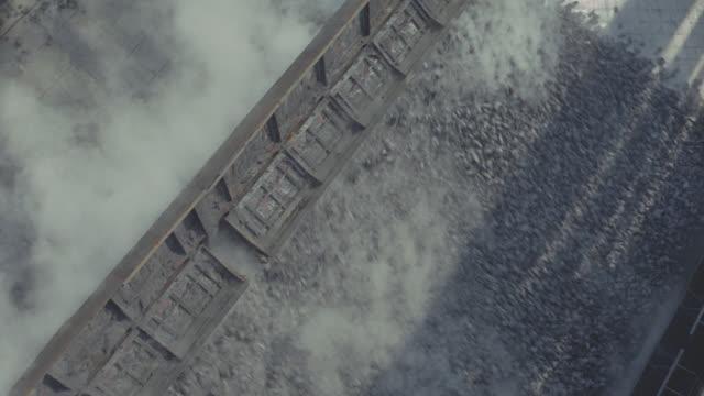 coke factory; grey coals being dumped; red coals on conveyor belt - kohle stock-videos und b-roll-filmmaterial
