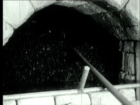 1927 b/w cu coke oven worker stoking coke through gap in partically-bricked up beehive coke oven/ pennsylvania, usa - 1927 stock videos & royalty-free footage