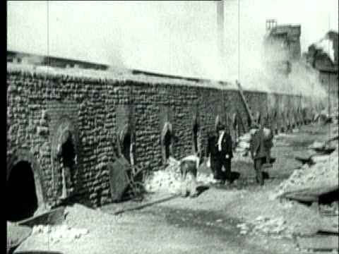 1927 B/W WS Coke oven workers standing around battery of smoking beehive coke ovens/ Pennsylvania, USA