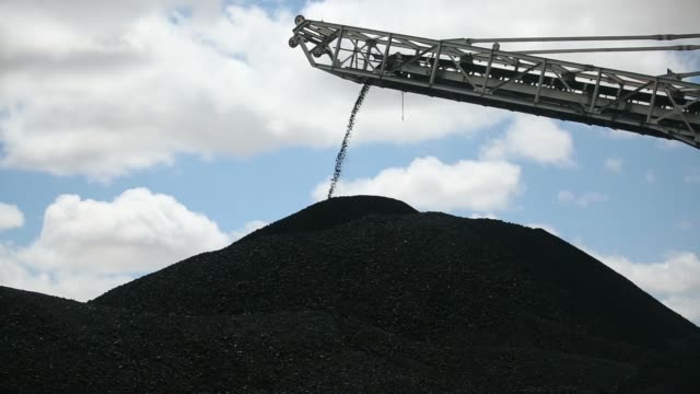 Coking coal falls from a conveyor onto a stockpile at the coal handling and preparation plant of Energy Resources LLC a subsidiary of Mongolian...