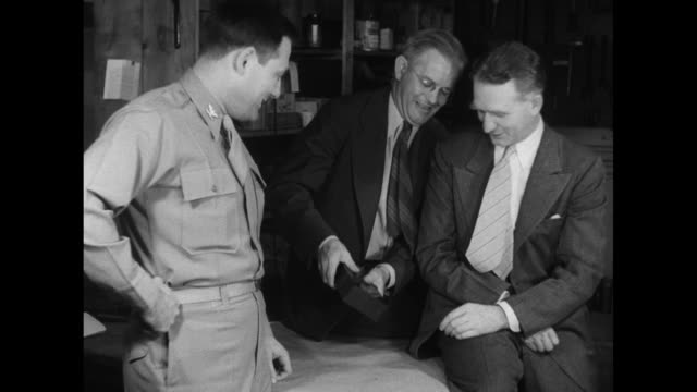 col arthur faye walter zinn and norman hilberry goodnaturedly hoist a brick of heavy uranium at the argonne national laboratory - uranium stock videos & royalty-free footage