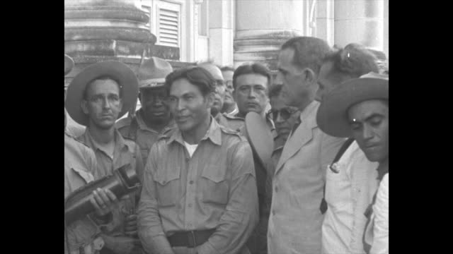 Col Fulgencio Batista leader of new ruling junta in Cuba on left and newly appointed President Ramon Grau San Martin standing together with other...