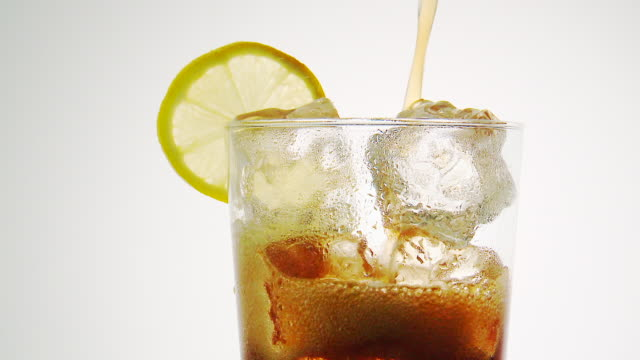 cu cola drink pouring in glass with ice - cola stock videos & royalty-free footage