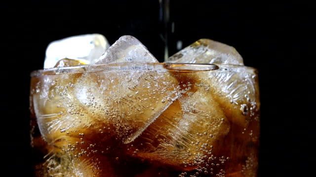 cola with ice cube black background - refreshment stock videos & royalty-free footage