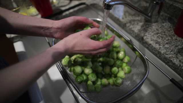 colander of brussel sprouts - brussels sprout stock videos & royalty-free footage
