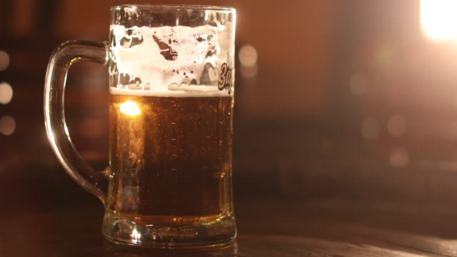 cold beer - pint glass stock videos & royalty-free footage