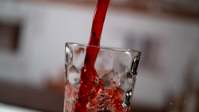 cold cherry juice pouring into glass. super slow motion - juice drink stock videos & royalty-free footage