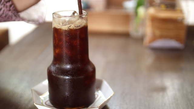 cold coffee with ice - traditional lemonade stock videos & royalty-free footage