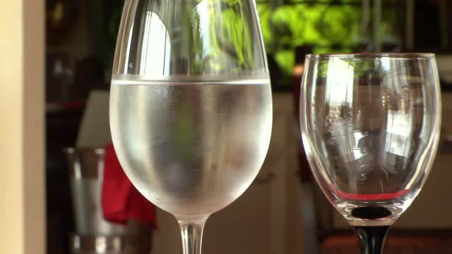 cu zo cold glass of white wine on fancy table at luxury restaurant / phnom penh, cambodia - white wine stock videos and b-roll footage