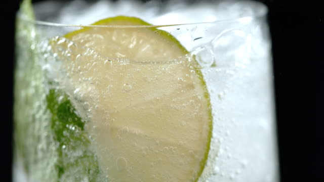 slo mo tu cold lime drink - cocktail stock videos & royalty-free footage