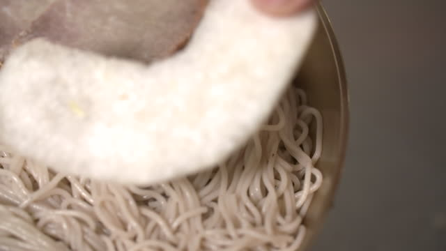 cold noodles (or naengmyeon) with the pear slices in the bowl (korean noodle dish) - pear stock videos & royalty-free footage