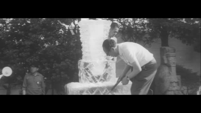 vídeos de stock e filmes b-roll de cold olympics/lighting an olympic torch platform made of ice with dry ice ice art presentation foreign model wearing a yukata - 1964