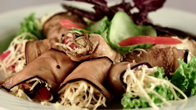 cold starter. eggplant rolls stuffed with grated cheese and tomatoes - grated stock videos & royalty-free footage