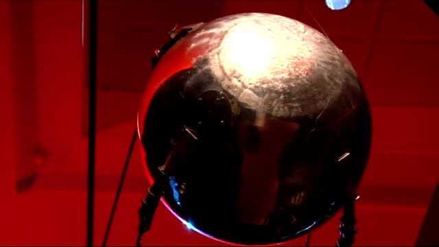 cold war modern design exhibition at victoria & albert museum; space suits on display section of display with large video screen above sputnik... - sputnik stock videos & royalty-free footage