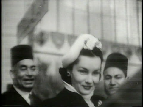 1949 / cold war / princesses fawzia and faiza attend world's fair exhibition / close ups of fawzia and faiza walking through crowd in exhibition hall... - 1949 stock videos and b-roll footage