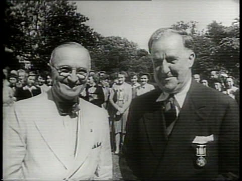1949 / cold war / stephen t early appointed as first under secretary of defense in 1949 / early shakes hands with scott w lucas / early working at... - segretario della difesa video stock e b–roll