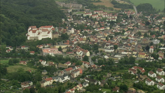 aerial colditz castle and surrounding town, colditz, saxony, germany - saxony stock videos & royalty-free footage